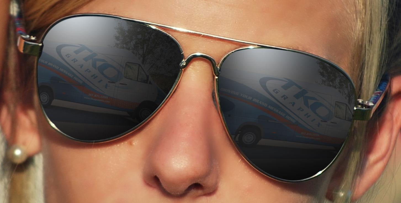 girl wearing aviator sunglasses - tko vehicle in reflection