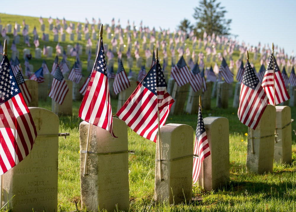 American flags at grave markers