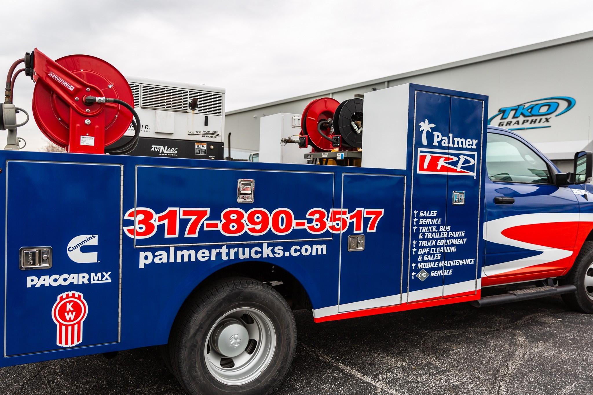 Palmer TRP Truck Wrap parked behind TKO Grpaphix