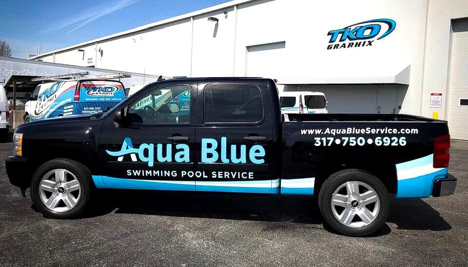 5 Vehicle Graphic Design Tips -- Aqua Blue Swimming Pool Service Work Truck Wrap parked in TKO Graphix lot