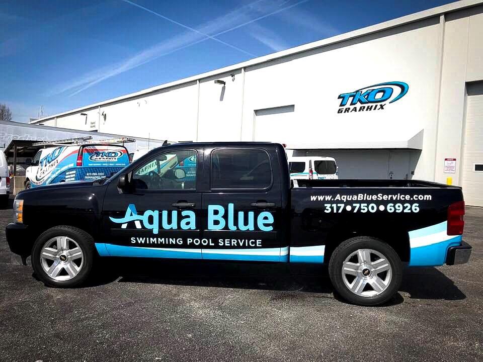 Aqua Blue Swimming Pool Service Work Truck Wrap parked in TKO Graphix lot