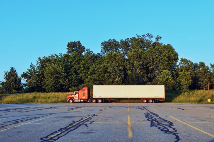 Tractor trailer in parking lot