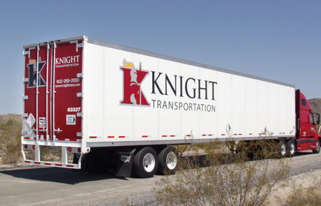Red Semi Truck and Trailer on Road - Knight Transportation