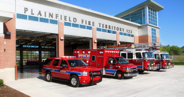 Two Fire Trucks, One Ambulance, and a Chevy Tahoe with Vehicle Graphics Parked at Fire Trucks