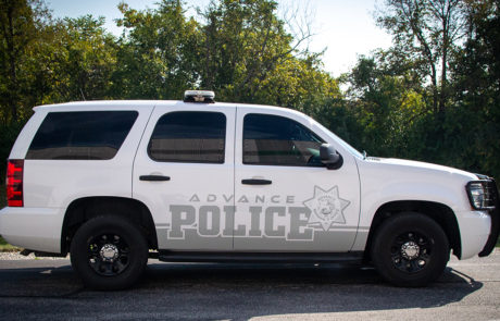 White Chevy Tahoe with Gray Advance Police Decals
