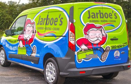 Ford Transit with Bright Green and Blue Graphics - Jarboe's Plumbing, Heating, Cooling