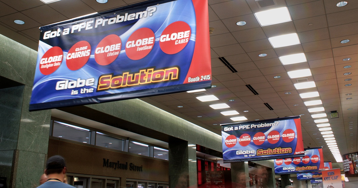 Multiple Banners Hanging from Ceiling in Hallway at Trade Show